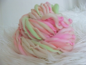 handspun thick and thin yarn, pink and green yarn, superwash yarn, slub yarn, handspun wool